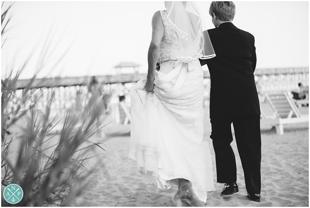 Son walking mom down the aisle at her wedding, Folly Beach Wedding, folly beach elopement, folly pier, Photo by Aaron Nicholas Photography, destination wedding photographer based in Charleston, South Carolina