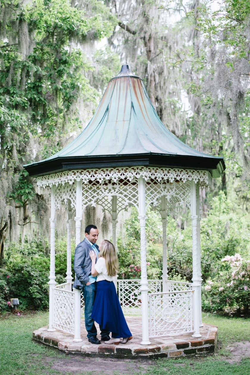 couple in the gazebo, Magnolia Plantation Proposal and Engagement Session by Aaron and Jillian Photography - Charleston Wedding Photographer