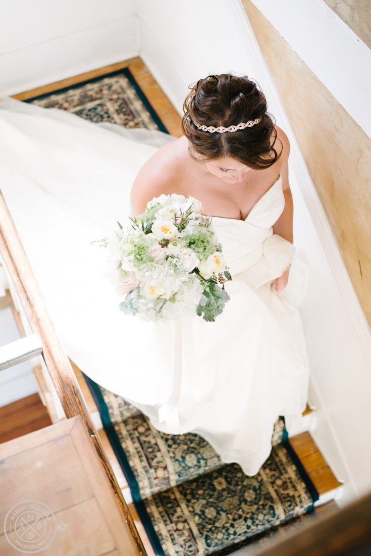Bride walking down the stairs at an Old Wide Awake Wedding. Photo by Charleston wedding photographers Aaron and Jillian Photography in South Carolina