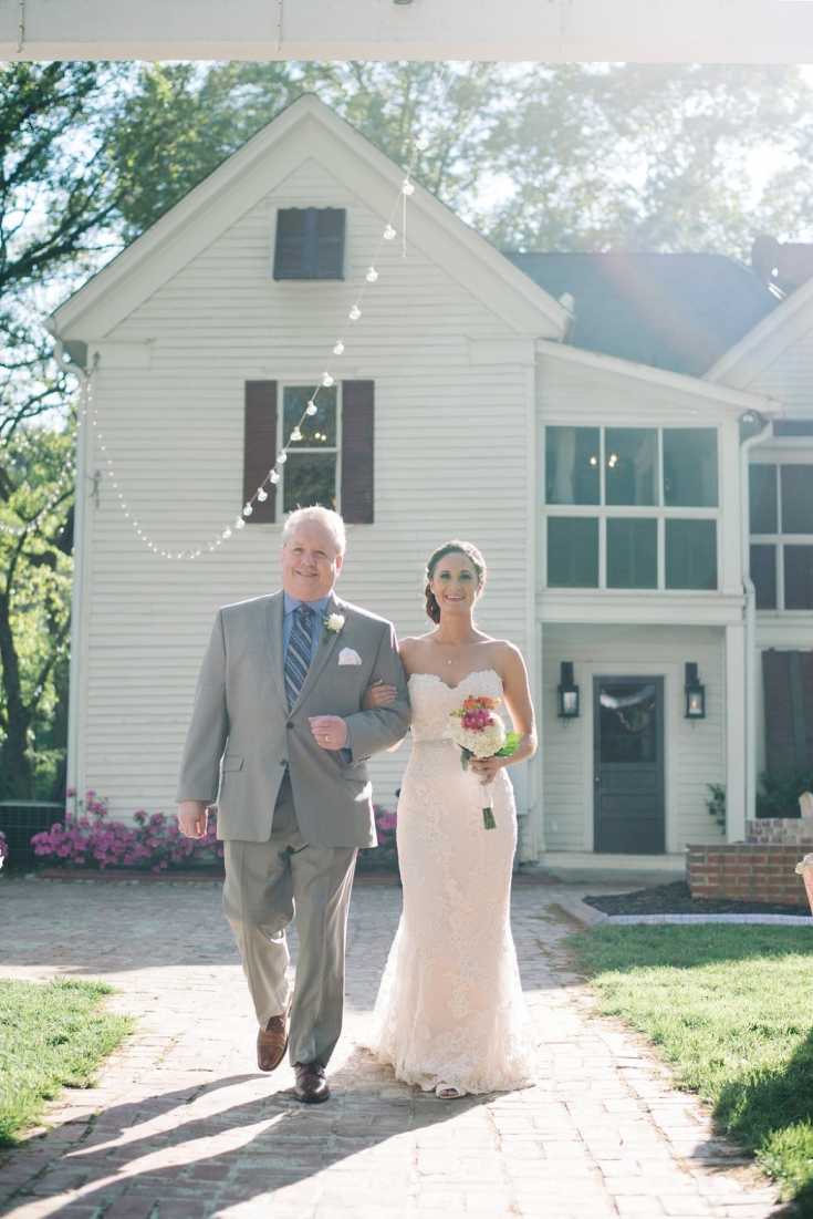 Bride and father of the bride walking up the aisle at a Wedding ceremony at The Wheeler House in Ballground, GA, April 2014 - Photo by Charleston wedding photographer Aaron and Jillian Photography
