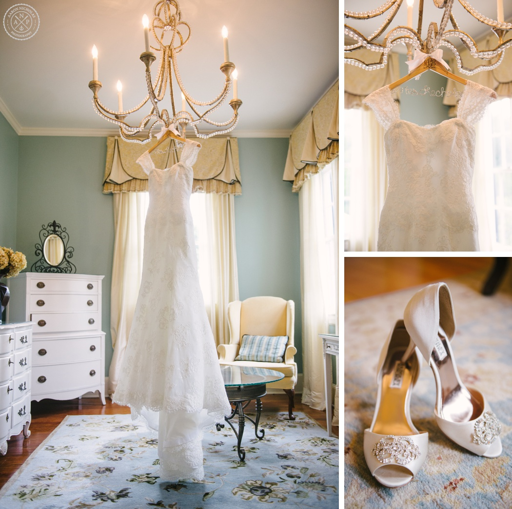 Wedding Dress hanging from the bridal suite chandelier at Megan and Kinon