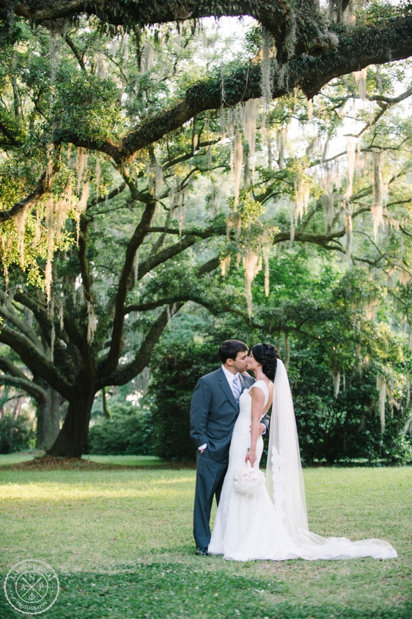 Aaron and Jillian Photography, Bride and groom under the giant oak trees at a Legare Waring House Wedding - photo by Charleston wedding photographer Aaron Nicholas Photography