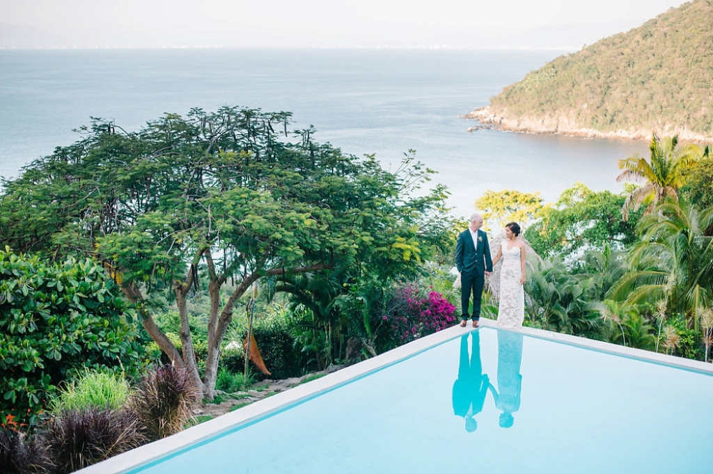 Bride and groom standing on a pool, mountain top wedding, dramatic wedding portraits, Destination wedding in Mexica at Verana small luxury spa and resort - Photos by Aaron and Jillian Photography -_0002
