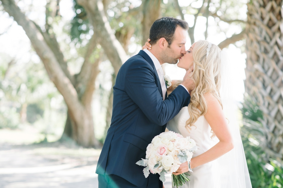 Bride and groom kissing at their at Lowndes Grove Plantation wedding by Aaron and Jillian Photography in Charleston, SC lowndes-grove-wedding-by-charleston-wedding-photographer-aaron-and-jillian-photography_0031