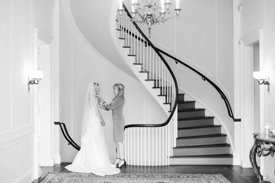 Mom walking bride down the aisle at a Charleston wedding at Lowndes Grove Plantation by Charleston wedding photographers, Aaron and Jillian Photography lowndes-grove-wedding-by-charleston-wedding-photographer-aaron-and-jillian-photography_0046