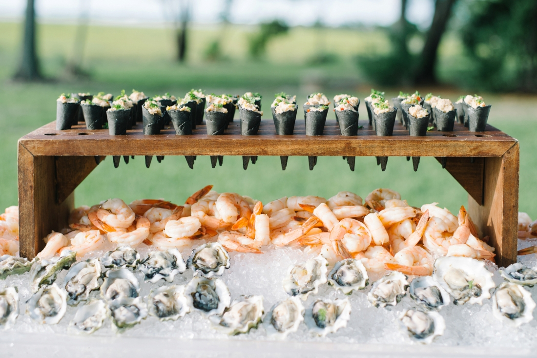 Patrick Properties oyster and shrimp bar at a Charleston wedding at Lowndes Grove Plantation by Charleston wedding photographers, Aaron and Jillian Photography lowndes-grove-wedding-by-charleston-wedding-photographer-aaron-and-jillian-photography_0060