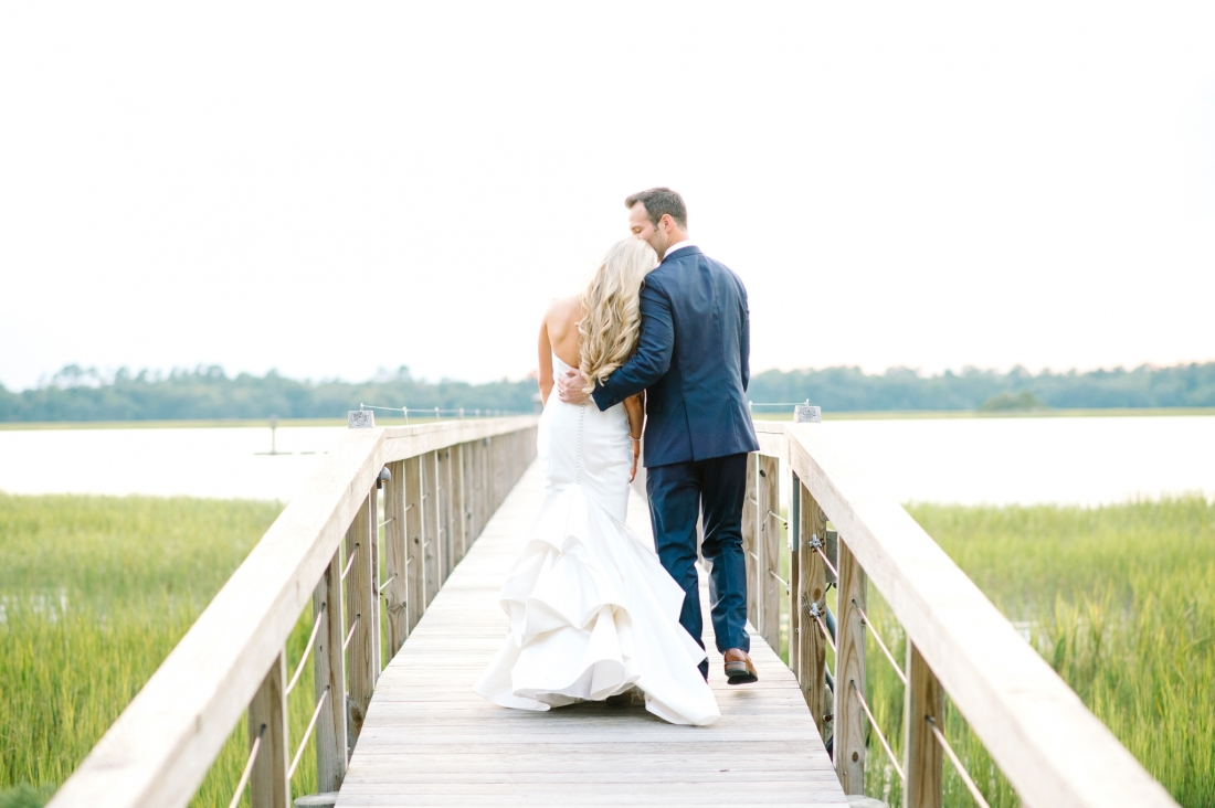 Romantic wedding photo on the dock at sunset at a Charleston wedding at Lowndes Grove Plantation by Charleston wedding photographers, Aaron and Jillian Photography lowndes-grove-wedding-by-charleston-wedding-photographer-aaron-and-jillian-photography_0077