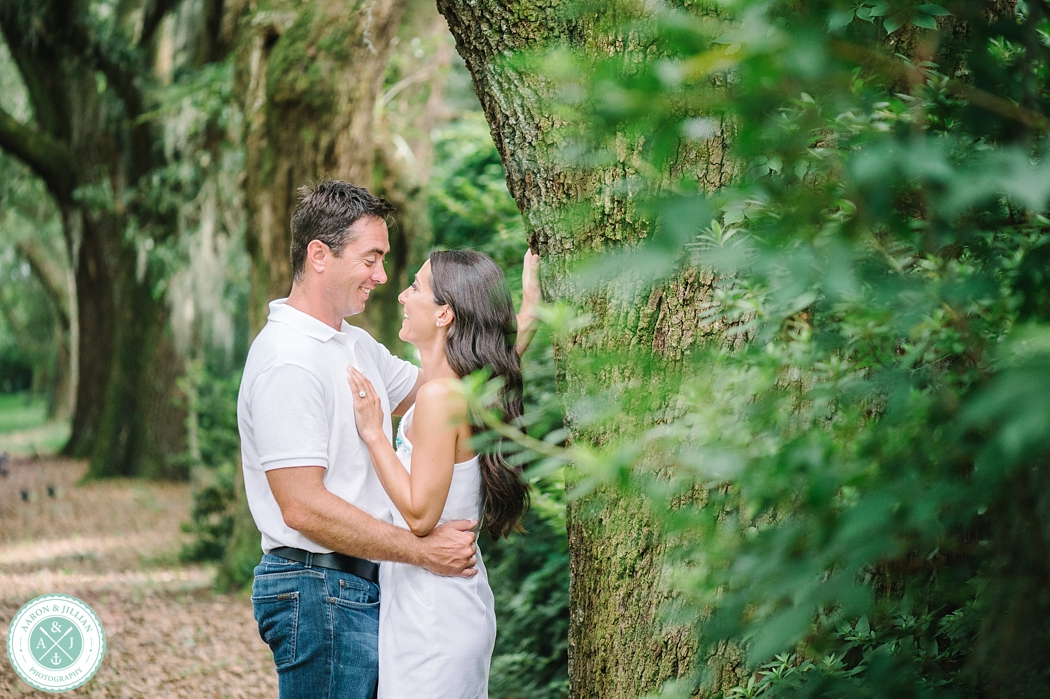 Couple in the Avenue of Oaks at The Legare Waring House. Engagement photos by Charleston wedding photographers Aaron and Jillian Photography