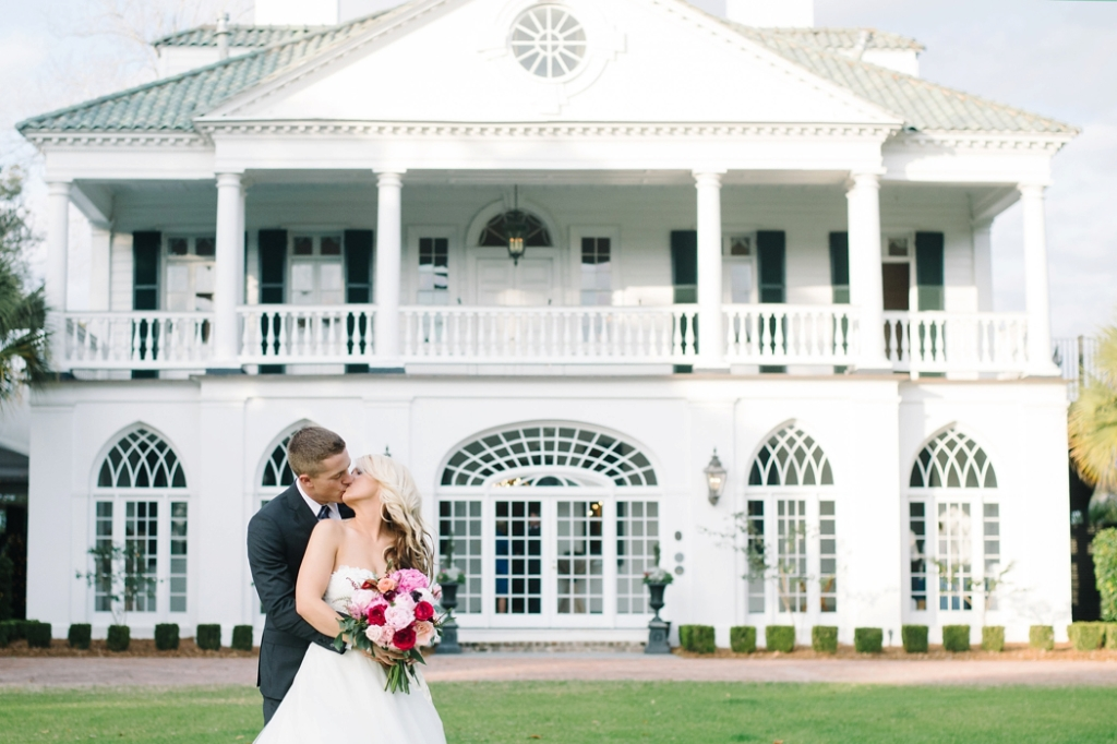 Bride and groom portraits at Lowndes Grove Plantation, bride and groom in front of a plantation home, On a Limb florals, great flowers for December weddings, December Lowndes Grove Wedding by Charleston Wedding Photographer Aaron and Jillian Photography -_0001